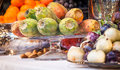 Italy luxury table arrangement seasonal fruit traditional sicilian sweets Royalty Free Stock Photos