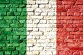 Italy national flag painted on a brick wall with the traditional green, white and red colors. Royalty Free Stock Photo