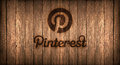 Italy, november 2016 - Pinterest logo printed on fire on a wood