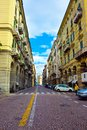Savona Clock Tower, Street with Yellow Buildings, Travel Italy, Italian Vintage Architecture Royalty Free Stock Photo