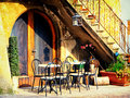 Italy tables and chairs at a bistro in Royalty Free Stock Photography