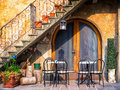 Italy tables and chairs at a bistro in Stock Photography