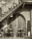 Italy tables and chairs at a bistro in Royalty Free Stock Photo