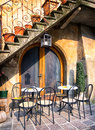Italy tables and chairs at a bistro in Royalty Free Stock Image