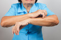 Itching In A old woman Royalty Free Stock Photo