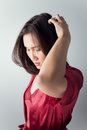 Itchy scalp itching in a woman on white background Stock Images