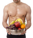Its healthy advice eat fruit isolated fitness man offers healthy diet Stock Photo