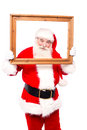 Its my new profile picture santa claus looking through empty frame Royalty Free Stock Images