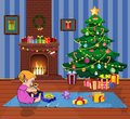 Ittle baby girl open gift boxes with presents in living room with Christmas tree and fireplace