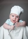 Ittle boy in a chef hat little with spoon hand and Royalty Free Stock Photography