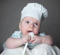 Ittle boy in a chef hat little with spoon hand and Stock Photography