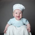 Ittle boy in a chef hat portrait of little on gray background Stock Photo