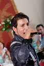 Iulian Vasile sings for the crowd. Royalty Free Stock Images