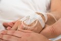 Iv drip in patient's hand Royalty Free Stock Photo