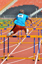 Ivan bogun jumping throught the hurdles photo was taken during junior team of ukrainian championship in athletics between Royalty Free Stock Photo