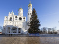 Ivan the Great Bell-Tower complex with New Year Christmas tree. Cathedral Square, Inside of Moscow Kremlin, Russia.