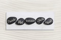 Ive black stones with german text for happiness, courage, trust, Royalty Free Stock Photo