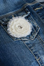 Ivory flower broochon denim background Royalty Free Stock Photo