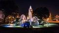 Couple talks in Kansas City at J C Nichols Memorial Fountain at night Royalty Free Stock Photo