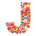 J Letter  made of giftboxes Royalty Free Stock Photo