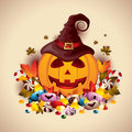 Jack o lantern with candies lots of different treats and foliage Royalty Free Stock Photography