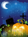 Jack o lantern on a cemetery evil pumpkin head night abstract halloween background Stock Photography
