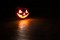 Jack o lantern in the dark on the floor Royalty Free Stock Image