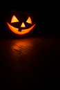 Jack o lantern in the dark on the floor Royalty Free Stock Photos