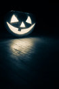 Jack o lantern in the dark on the floor Stock Photo