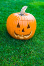Jack o lantern on green grass halloween time Stock Photography