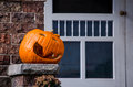 Jack-o-lantern on the porch Royalty Free Stock Images