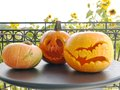 Jack o lantern pumpkins on metal garden table Stock Photos