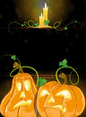 Jack o lanterns and burning candles pumpkin monsters with glowing eyes on a dark background Royalty Free Stock Photo