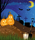 Jack o lanterns on a cemetery funny night abstract halloween scene Stock Photography