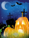 Jack o lanterns on a cemetery pumpkin head night abstract halloween background Stock Images