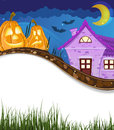 Jack o lanterns near the house two pumpkin heads brick halloween scene with place for text Stock Image