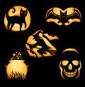 Jack o lanterns set of halloween symbols on pumpkins Stock Images
