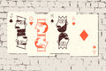 Jack, Queen, King and Ace. Stylized playing cards in grunge style on the brick wall background. Vector illustration. Royalty Free Stock Photo