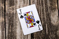 Jack of spades card on wood from a deck cards laying vintage table background old west salon style Royalty Free Stock Images