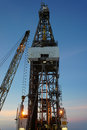 Jack up drilling rig oil drilling rig crane twilight time Royalty Free Stock Photo