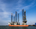Jack up rig in esbjerg oil harbor denmark with six legs Stock Photos