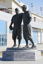 Jackie robinson and pee wee reese statue in brooklyn in front of mcu ballpark new york march Stock Photos