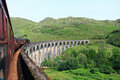 The jacobite train crossing glenfinnan viaduct Royalty Free Stock Images