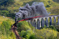The jacobite train glenfinnan viaduct highland scotland uk Royalty Free Stock Photo