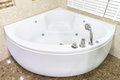 Jacuzzi in corner of bathroom Royalty Free Stock Photo