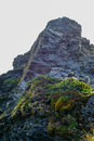 Jagged rock outcrop basalt at mountain peak Royalty Free Stock Image