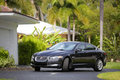 Jaguar XF parked in the driveway Royalty Free Stock Photo