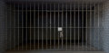Jail cell full view with keys a of a prison holding consisting of a brick and concrete room enclosed metal bars and a closed door Stock Photos