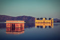 Jal mahal water palace jaipur rajasthan india vintage retro hipster style travel image of landmark on man sagar lake on sunset Royalty Free Stock Photography