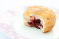 Jam doughnut with a mouthful taken out and showing on a plate Royalty Free Stock Photography